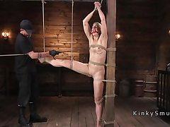 Platinum-blonde marionette screwed in wire suspension